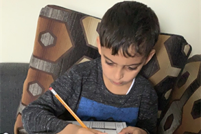 Mousa from class 2F concentrating on his math work